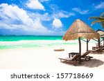 beds and umbrella on a tropical ... | Shutterstock . vector #157718669
