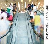 People Rush On Escalator Motio...