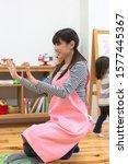 Nursery school teacher playing with children
