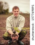 the young man plants a tree. | Shutterstock . vector #157769891