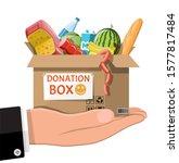 cardboard box full of food in... | Shutterstock . vector #1577817484