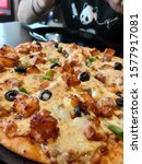 Small photo of Pizza-maniacs in Bangalore have good reason to munch their way around the city. After all, the city's many pizzerias, fancy and humble, have made it their mission to send you into a blissful tizzy.