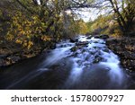 River in Autumn flowing in long expsure