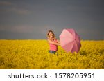 A Young Woman Standing In A...