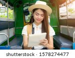 asian woman tourist write notes ... | Shutterstock . vector #1578274477
