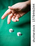 Hand Throws Dice On A Table...