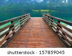 Wood Pier Over Mountain Lake...