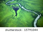Aerial view of a green landscape with a river - stock photo