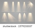 Set of Spotlight isolated on transparent background. Vector glowing light effect with gold rays and beams