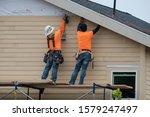 Construction Workers Installin...