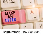 Small photo of Handwriting text Make An Offer. Concept meaning Proposal Bring up Volunteer Proffer Bestow Bid Grant White pc keyboard with empty note paper above white background key copy space.