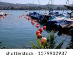 Red Buoys And Boats On The...