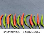 red and green chillies on black ... | Shutterstock . vector #1580206567