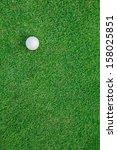 White Golf Ball On Green Grass...