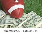 a college style football sits... | Shutterstock . vector #158031041