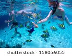young friends snorkeling and... | Shutterstock . vector #158056055