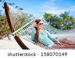 beautiful woman relaxing at... | Shutterstock . vector #158070149