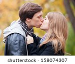couple kissing at outdoor in... | Shutterstock . vector #158074307