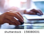male hand holding computer... | Shutterstock . vector #158080031