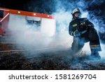 Fireman Team In Full Gear...
