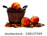 Harvest basket with apples on a white background - stock photo