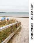 Small photo of beach with gangplank and beach chair