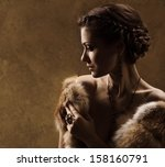 Woman In Luxury Fur Coat....
