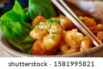 Small photo of closeup on a dynamite shrimps fresh dish served in a fancy decoration