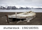 Old wooden whaling boat on the beach at Whaler
