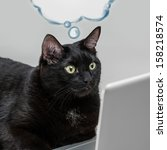 Stock photo black solid cat working with laptop big boss funny concept blank cloud balloon with its thoughts 158218574