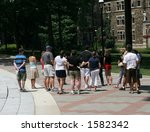 Stock photo group of people taking tour of university 1582342