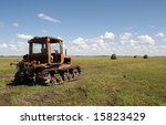 Old Tractor On The Meadow At...