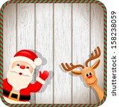 Santa And Reindeer In Christma...