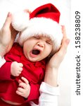 Cute Baby In Santa Hat Sleepin...