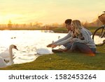 Young couple near lake with...