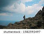 traveler hiker walks up  the mountain