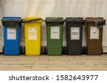 """Small photo of """"Cracow, Lesser Poland/Poland - 04.27.2019: garbage segregation bins for new system of segregation in Poland"""""""