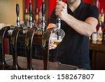 barkeeper pulling a pint of... | Shutterstock . vector #158267807