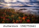 Misty Mountain Sunrise With...