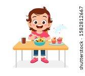 happy cute kid girl eat healthy ... | Shutterstock .eps vector #1582812667