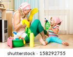 Happy Mother With Kid Cleaning...