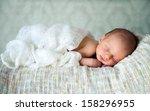 newborn baby boy asleep | Shutterstock . vector #158296955