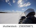 A Man Rides A Snowmobile On A...