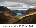 Epic Autumn Fall landscape of Buttermere and Crummock Water surrounded by mountain peaks in Lake District