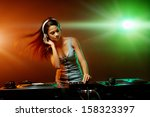 real woman dj playing music at... | Shutterstock . vector #158323397