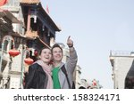 young couple sightseeing and... | Shutterstock . vector #158324171