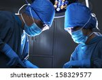 two surgeons working and... | Shutterstock . vector #158329577