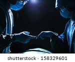 two surgeons working and... | Shutterstock . vector #158329601