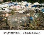 Small photo of detail of a pile of garbage illegally dumped in an open dump in a forest
