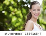 portrait of young woman smiling ...   Shutterstock . vector #158416847